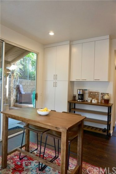 Kitchen is open to the backyard with large slider.  Are you crazy for coffee?  Imagine your morning cup of java from your private coffee bar!  It's included in the sale!