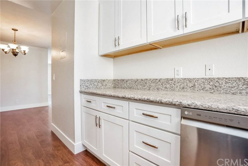 Completely updated kitchen with stainless appliances, granite and new cabinets