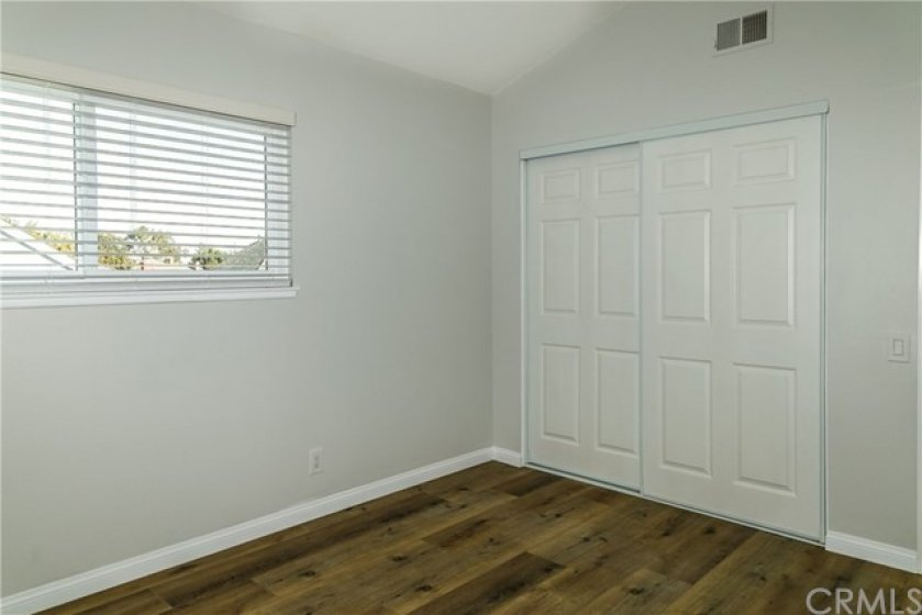 A GOOD SIZED SECOND BEDROOM EQUALLY AS BRIGHT WITH NEW CLOSET DOORS TOO.