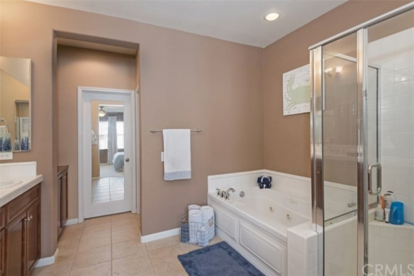 Masterbath also has relaxing jetted tub and clear glass enclosed shower