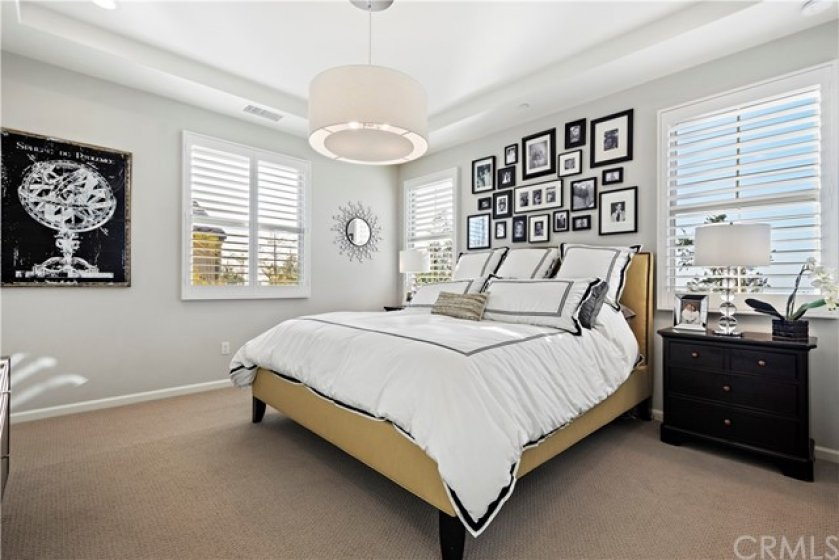Large Master bedroom with views out the windows behind the bed.  Lots of natural light.