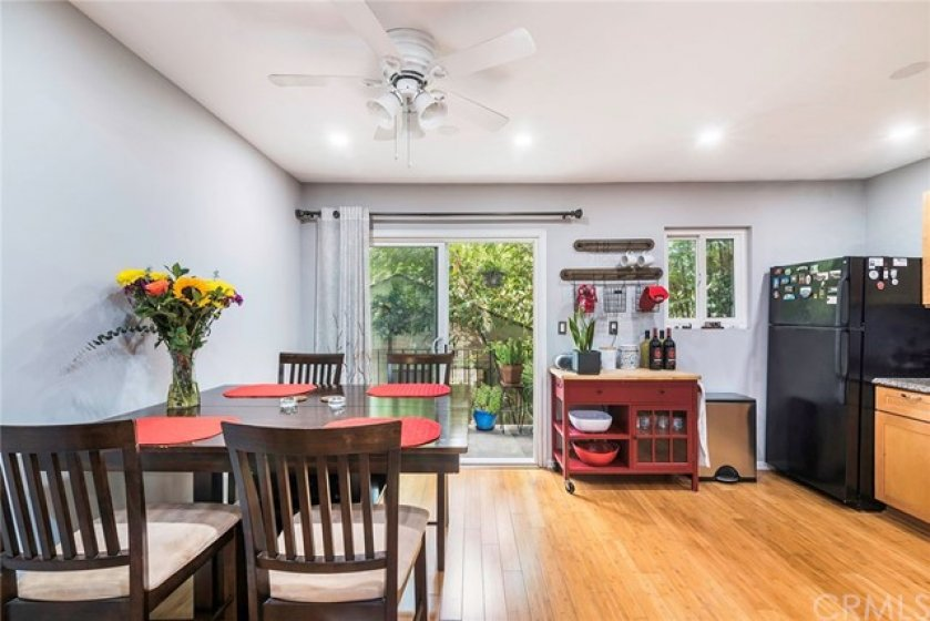 Kitchen and Dining Area have a sliding door leading to a tranquil patio balcony.