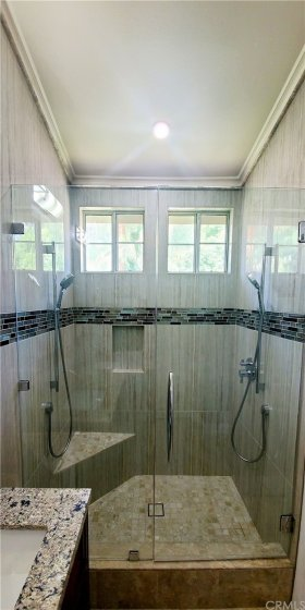 Master Bath  with dual shower head and tiled from floor to ceiling