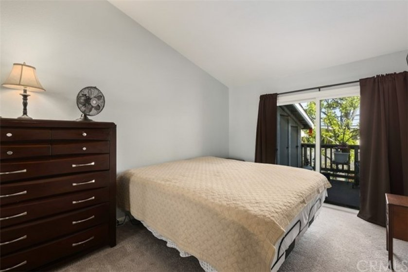 Relax in this spacious master bedroom with soaring ceilings and slider leading out to the balcony. The master has a large walk in closet with new cabinets and shelves.