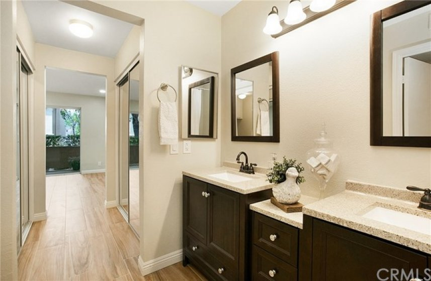 Remodeled master bath with separate tub and shower and dual vanities