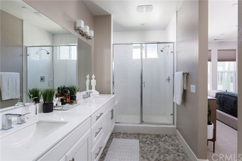 Master bathroom with dual sinks and walk-in shower.