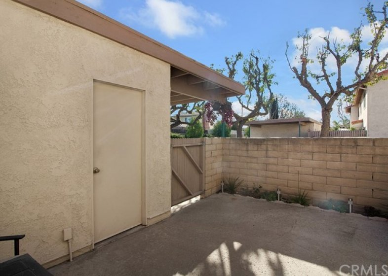 Private back patio.  You won't feel boxed in with this corner location.  Direct access to garage & carport.