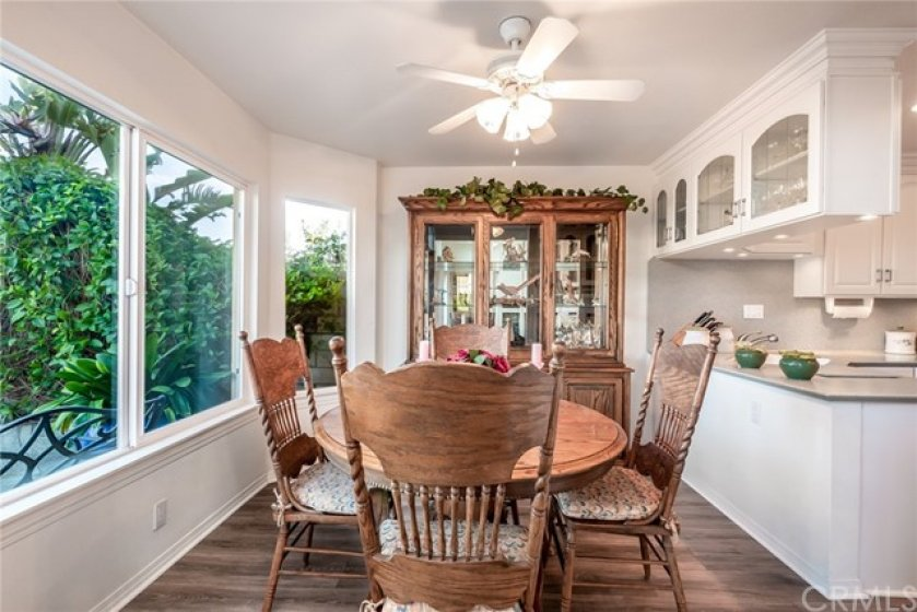 ADORABLE DINING NOOK  WITH VIEWS TO  THE BACKYARD AND SADDLEBACK MOUNTAINS..