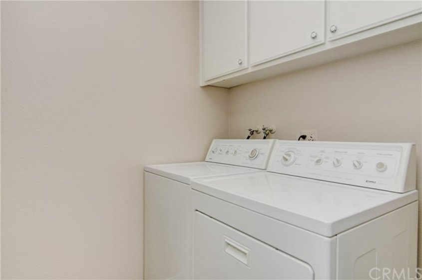GREAT LAUNDRY ROOM WITH STORAGE.