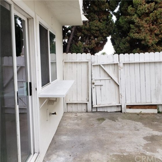Gate from outside. Private entrance for bedroom/bath over garage.