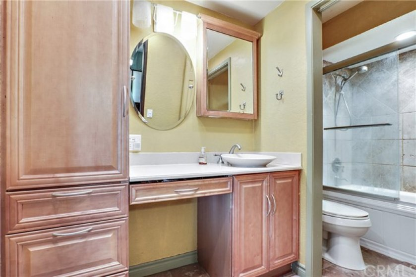 The master bath has been remodeled with maple cabinetry and a raised bowl sink.  Plenty of storage!