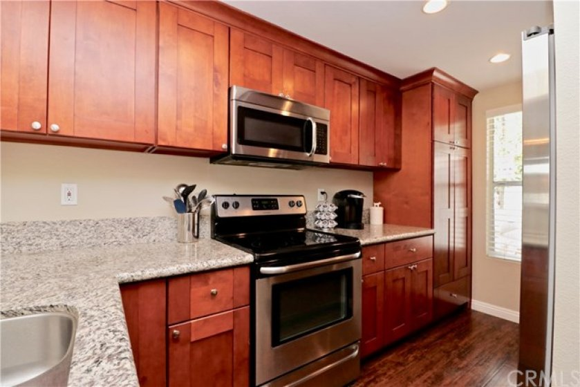 Updated kitchen with newer stainless steel appliances