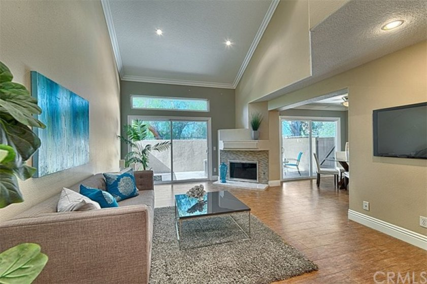 Rich wood tile, easy care flooring, large glass sliders in the living and dining rooms to the relaxing patio.