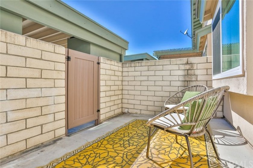 Your private back patio with entrance to your carport.