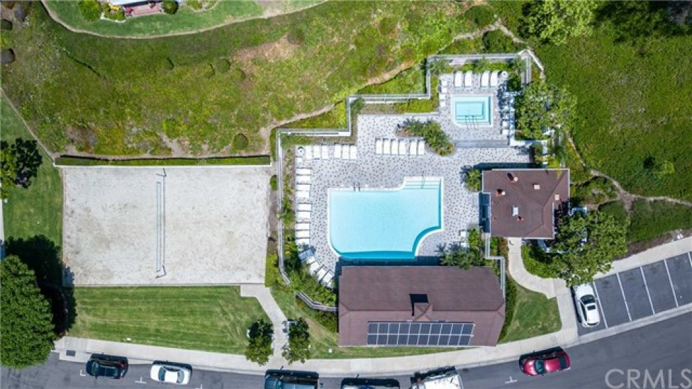 Community heated pool, spa and sand volleyball court
