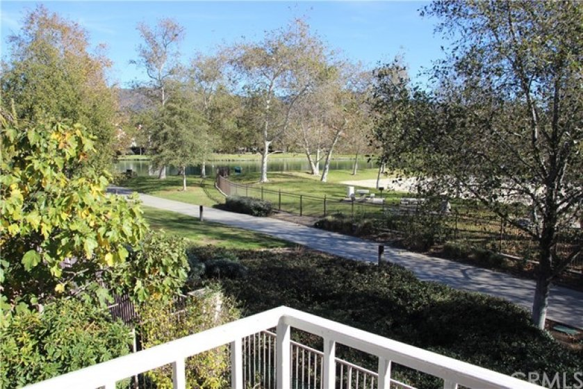View of Lake, Volleyball Court and Walking Path from living room.