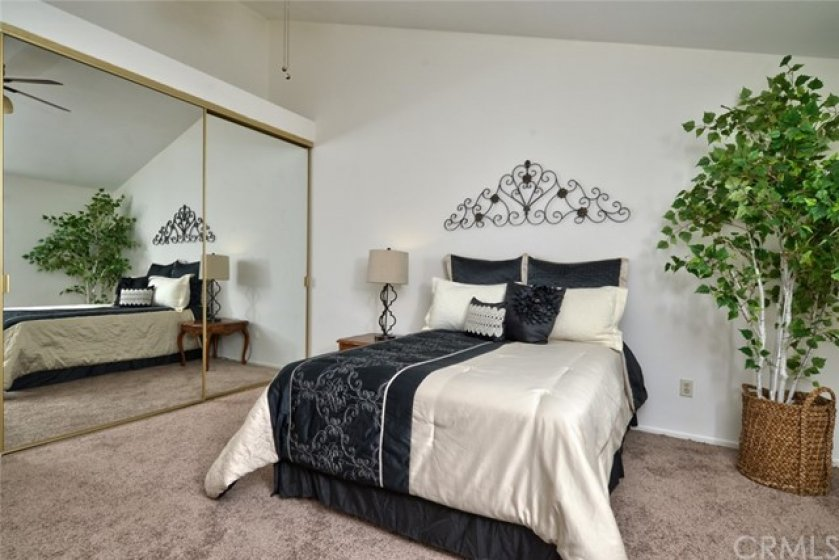 This view of the master suite shows the huge mirrored wardrobe closet and all the space for large furniture too!
