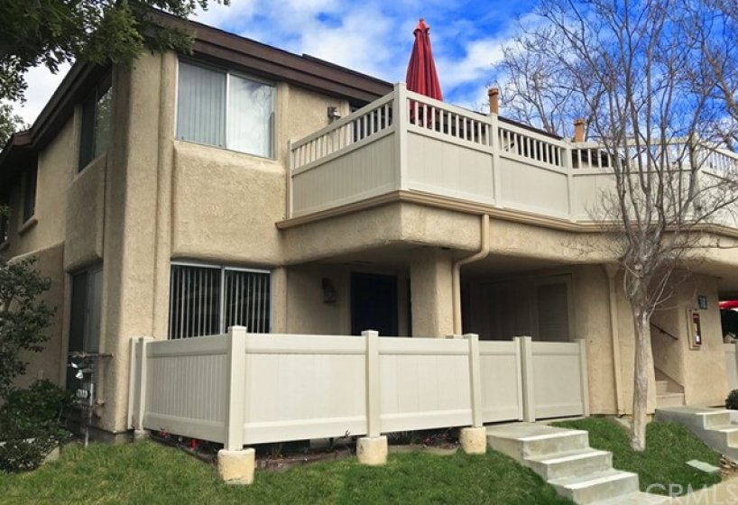 Lower End-Unit with spacious patio and new fence.