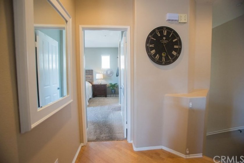 The master bedroom is to the right of the stairs.