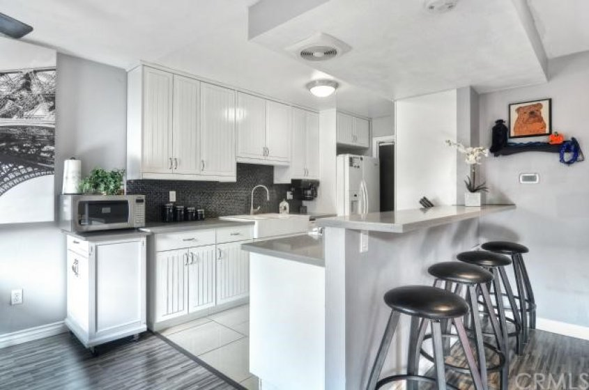 Your Kitchen has extensive counter space, exceptional cabinet space with gorgeous Quartz counter surfaces overlooking the Living Room.
