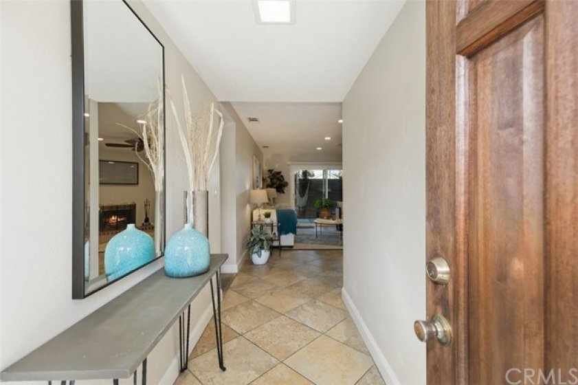 The Condo is Bright and Airy!  Walk through the entry with beautiful wood door into the great room.
