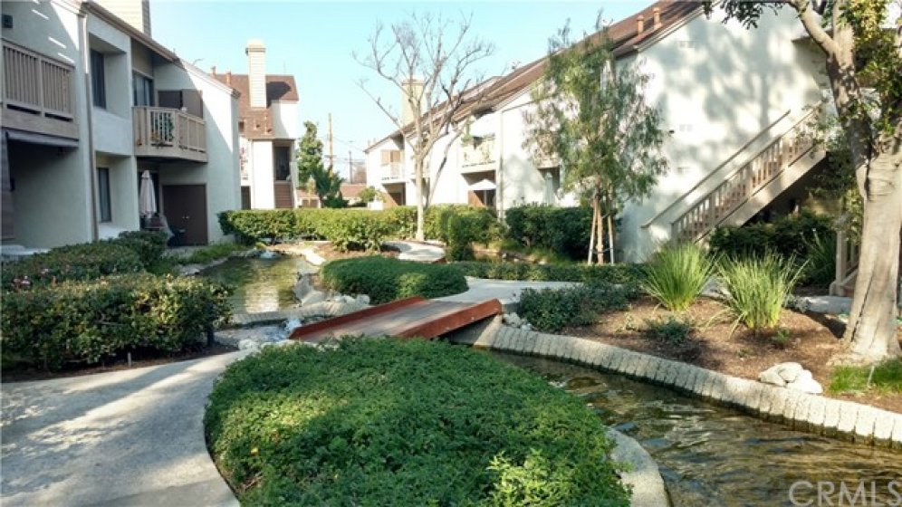 Gated development with serene creeks flowing throughout.
