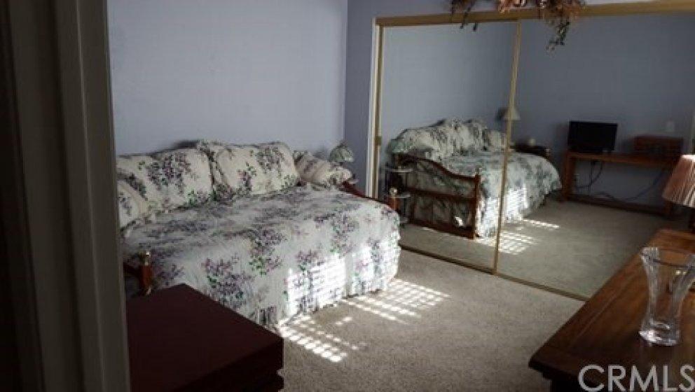 2nd bedroom with mirrored closet doors