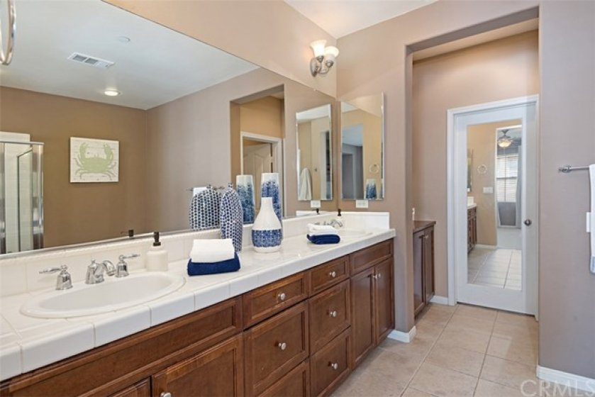 Master bath has dual sinks and access to a large walk-in closet