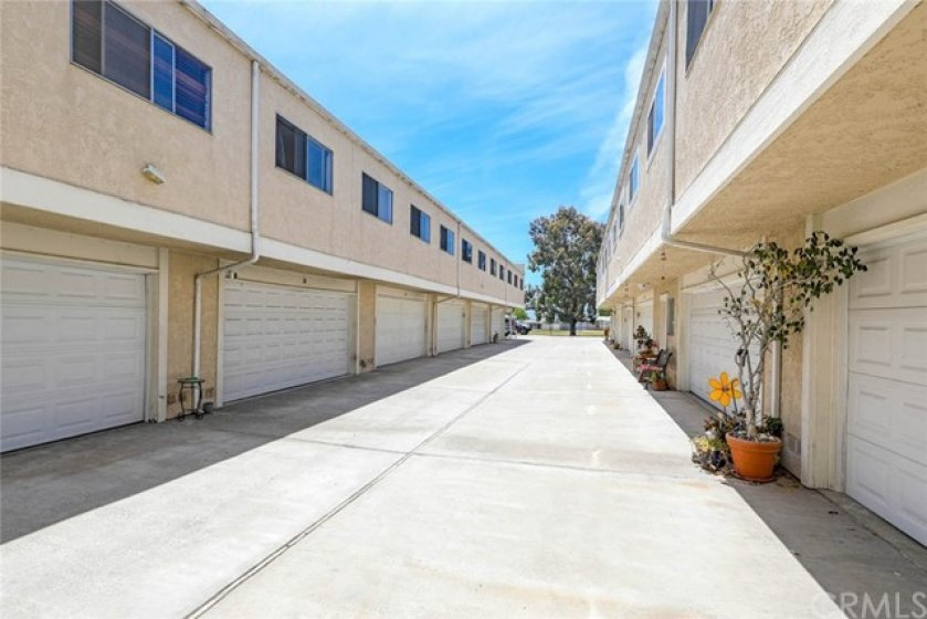 Wide alley way for easy access to your 2 car garage. In addition to your own laundry in your garage, there is also a community laundry facility onsite.
