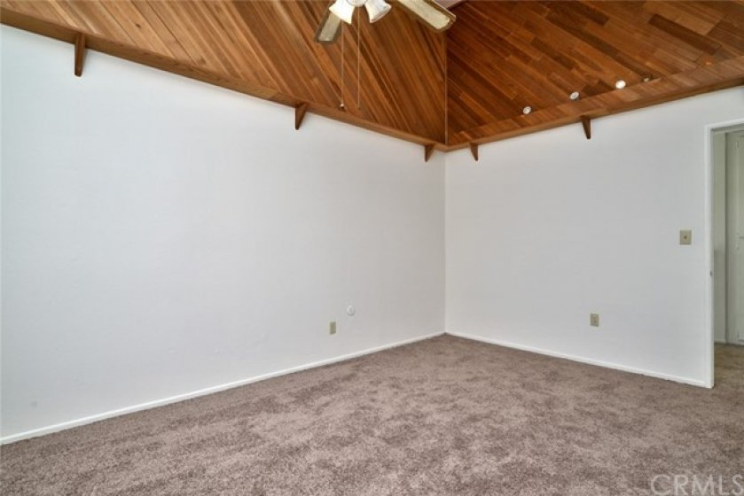 The closet was removed from this bedroom, but could easily be added back to the left of the doorway, or that wall would be a great place for a large armoire.