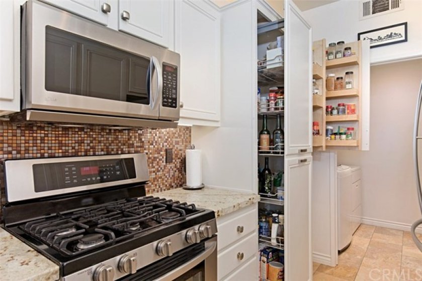 Modern kitchen with recently installed pantry pull-outs