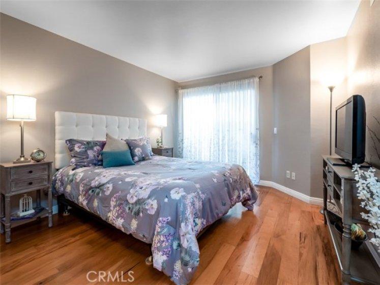 Charming Master Bedroom has wood floors