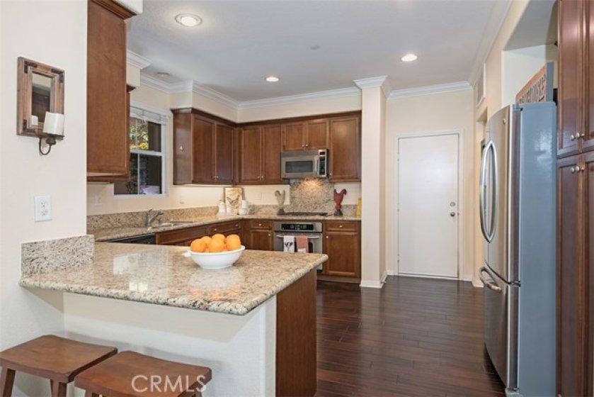 The large kitchen provides abundant storage plus gleaming granite work space