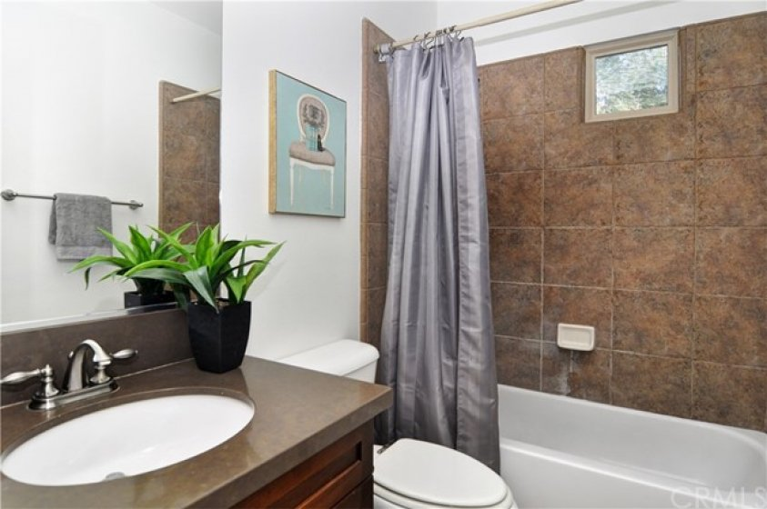 Secondary full bath is adjacent to secondary bedroom and is beautifully upgraded!