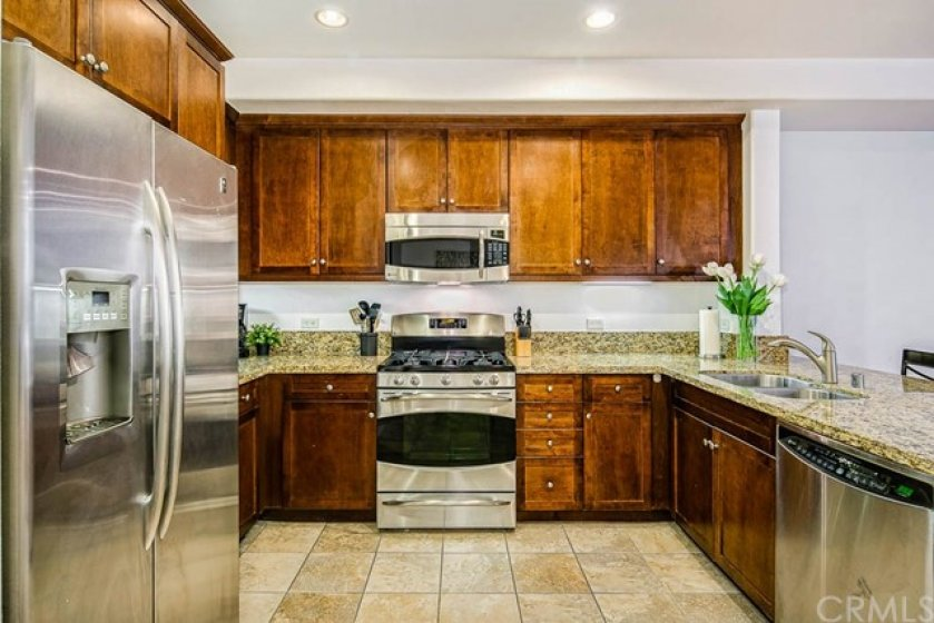 Home comes with all appliances including stainless gas range, microwave, dishwasher, large fridge, oven, laundry washer and dryer, and the built-in surround sound system.