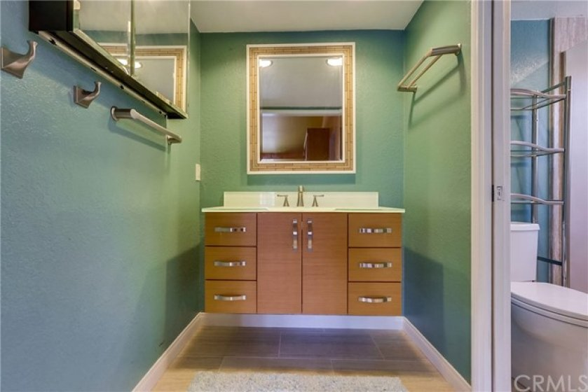 Oversized secondary bedroom and updated full bath complete the upstairs accommodations!