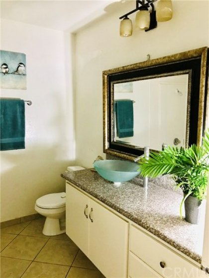 Hall Bathroom with Vessel Sink and Granite Counters. Tub with Shower in this room.