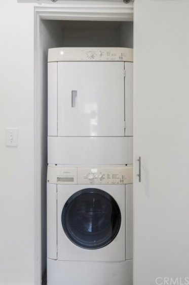 Stack-able washer and dryer included.  This is in the hallway and has its own closet.