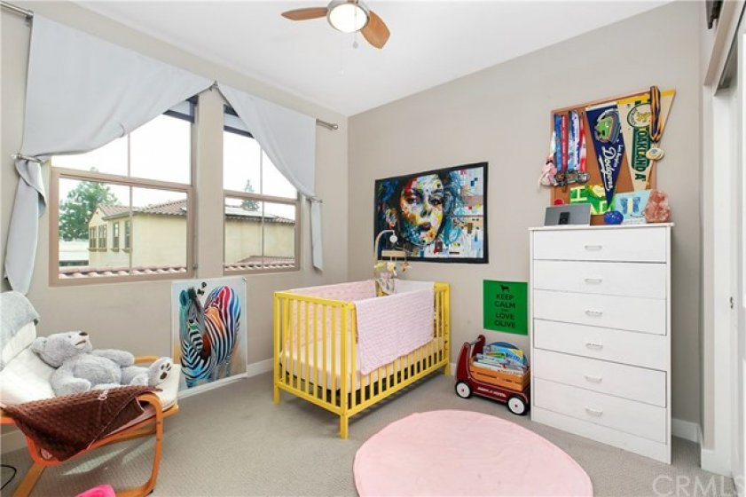 Large Windows in Second Bedroom with Ceiling Fan