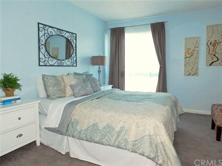 Bedroom is large and pretty!