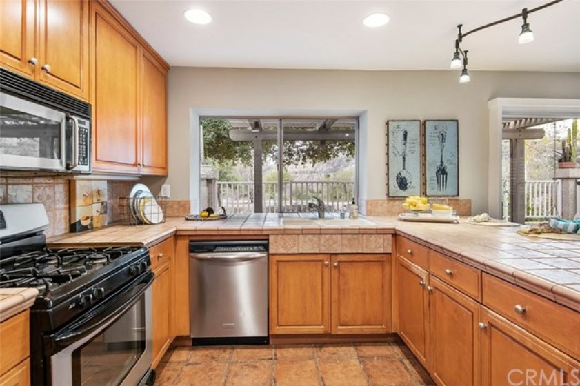 Kitchen with larger picture window with a view of the canyon and hills.