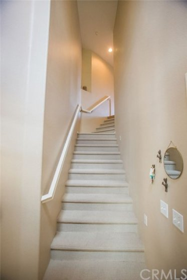 The stairs lead to the main floor residence which features 2 large bedrooms, 2 baths, open floor plan includes beautiful kitchen with island, spacious living room with fireplace, dining room, large covered deck, indoor laundry room and attached two car garage.