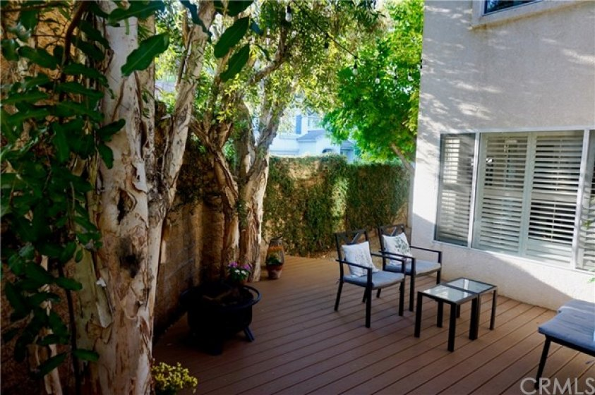 Backyard tranquility with shady entertaining area on the Trex Deck.