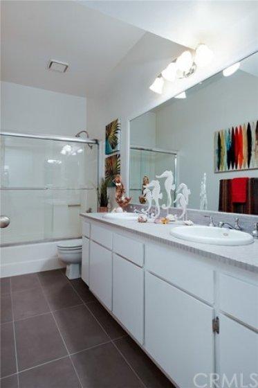 Large bathroom has double sinks