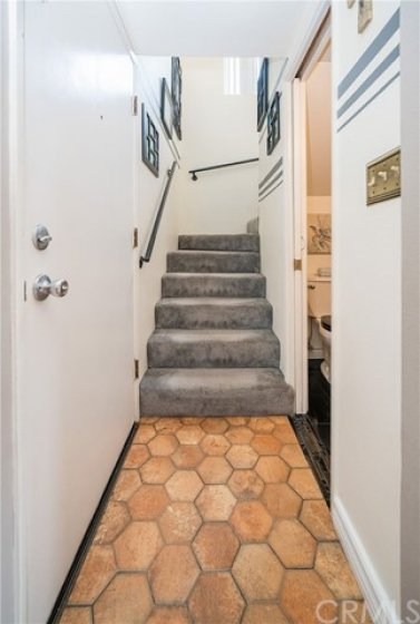 Beautiful mosaic floor leading to the upstairs bedrooms.