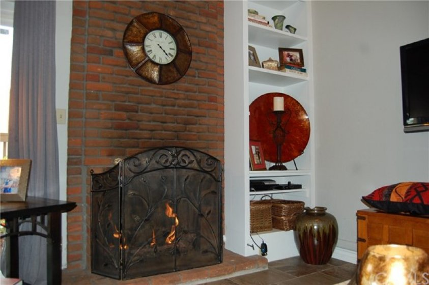 Close up View of Fireplace and Shelving