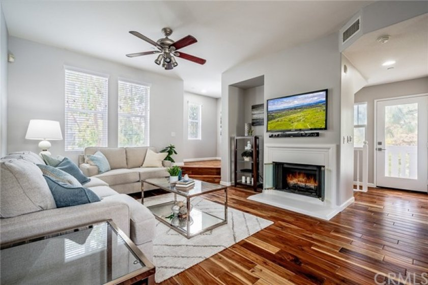 Rich hardwood floors and designer paint. Bright and airy