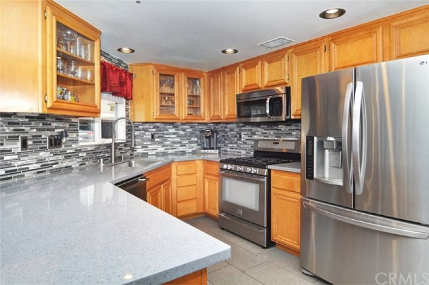 Upgraded Corian counter tops, updated back splash, Stainless Steel appliances.