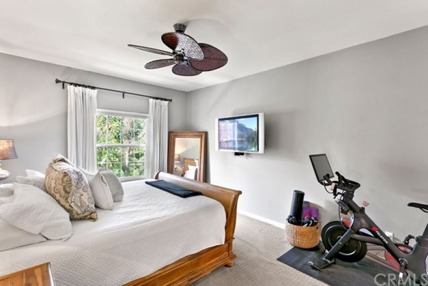Primary bedroom with ceiling fan.
