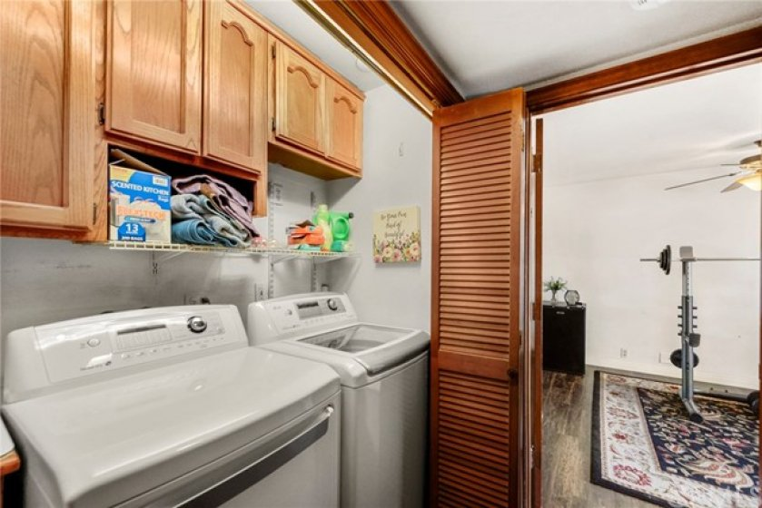 Full size laundry located just outside the Master Bedroom with plenty of storage!